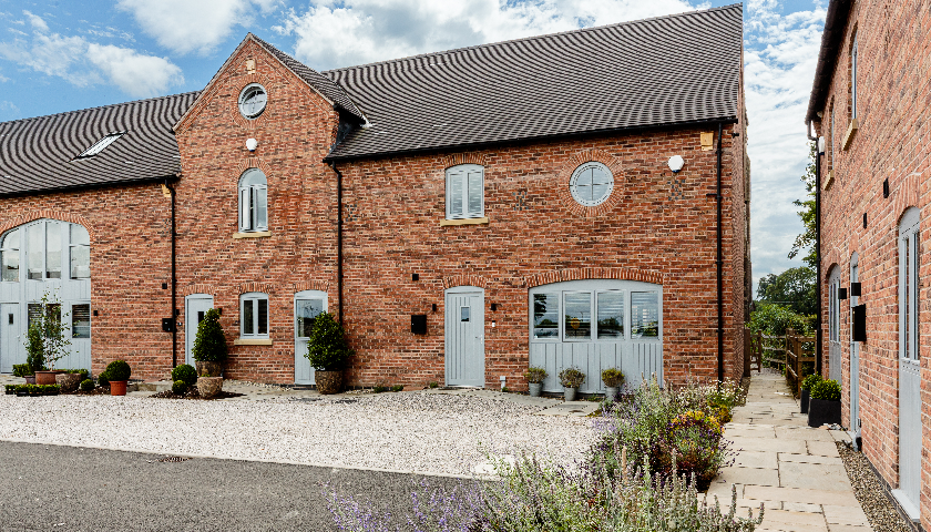Keystone brick slip feature lintels integral to Cheshire barn development